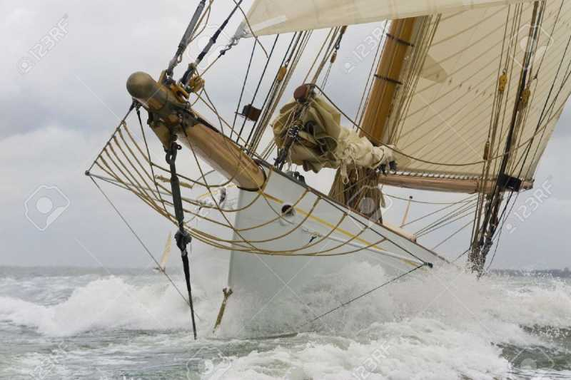 2946082-Close-up-on-the-bow-of-a-classic-sailboat-breaking-through-a-wave-Stock-Photo.jpg